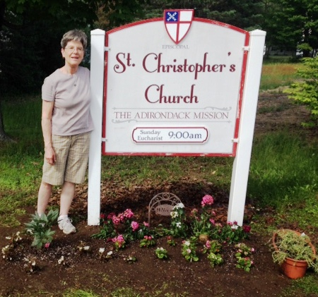 Dcn Nancy in the flower bed at St Chris